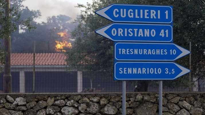 India Tv - Fires rage through the countryside in Cuglieri, near Oristano, Sardinia.