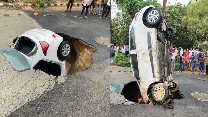 Delhi rains car swallowed, delhi rains car, dwarka sector 18, delhi rains, delhi car falls, delhi ca