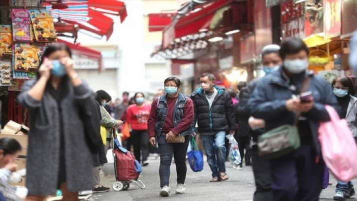 People wearing masks at a market in Hong Kong to prevent