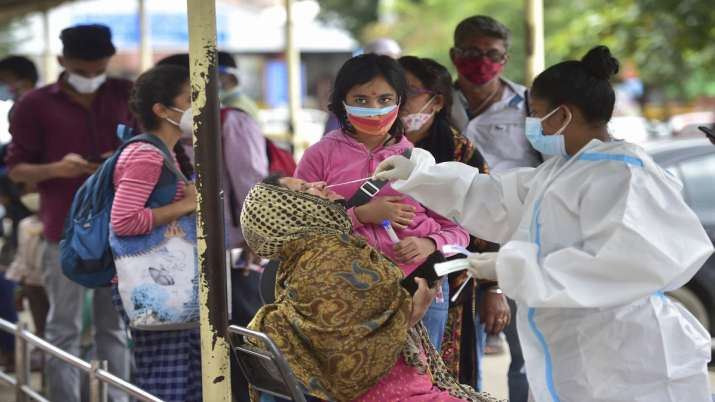 FILE  A health worker collects samples of passengers for
