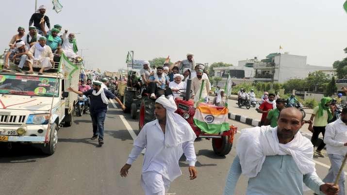 Farmers, under the leadership of BKU leader Naresh Tikait,