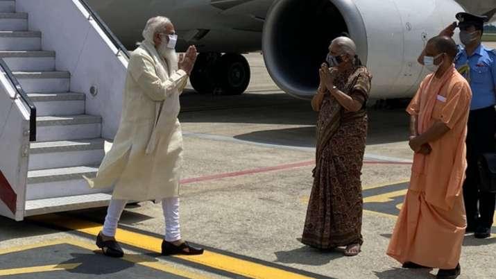 PM Modi arrives at Varanasi airport, to inaugurate multiple
