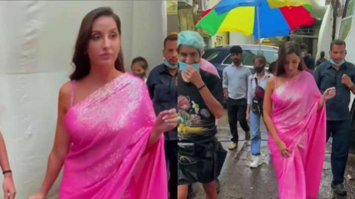 Nora Fatehi walks around in pink saree amid Mumbai rains; Netizen troll her and ask 'mask kahan hain