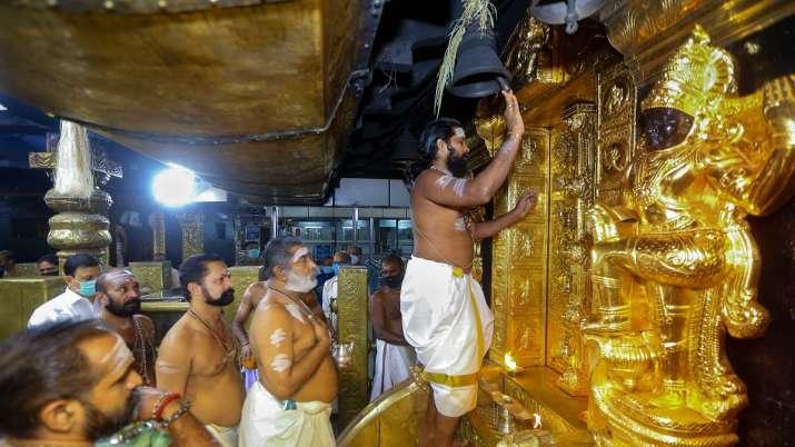 Priests perform rituals at Sabarimala Temple.