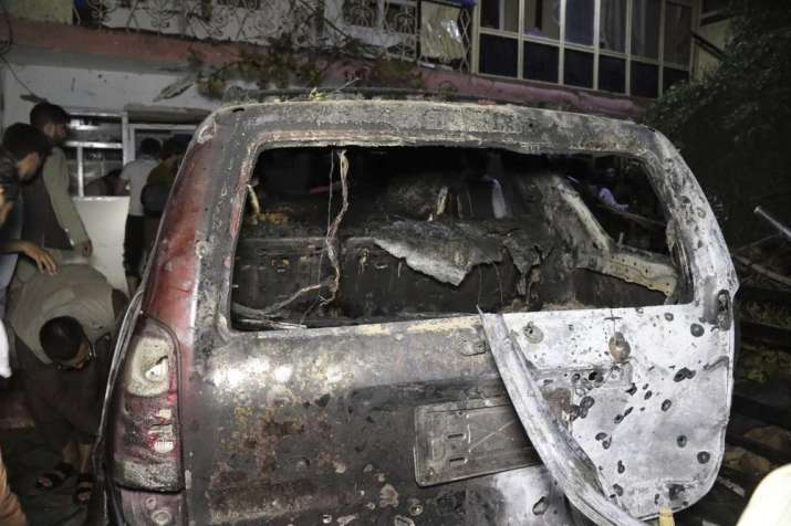 India Tv - A destroyed vehicle is seen inside a house after a U.S. drone strike in Kabul, Afghanistan, Sunday, Aug. 29, 2021. A U.S. drone strike destroyed a vehicle carrying
