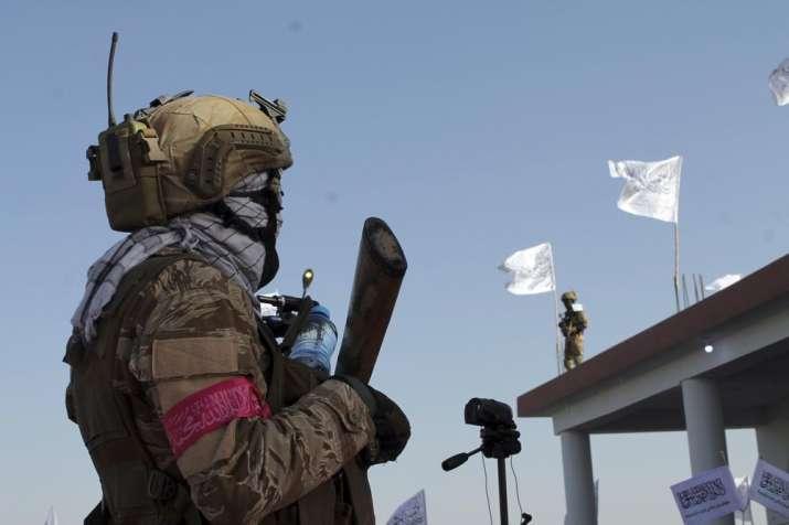 Taliban commando fighters stand guard in Lashkar Gah,