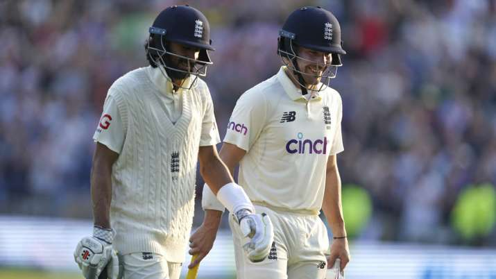 India Tv - England's Rory Burns, right, and Haseeb Hameed walk off the field at the end of play on the first day of third test cricket match between England and India, at Headingley cricket ground in Leeds, England, Wednesday, Aug. 25