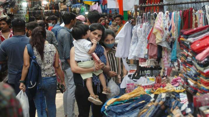 FILE | People visit a crowded market as the authorities