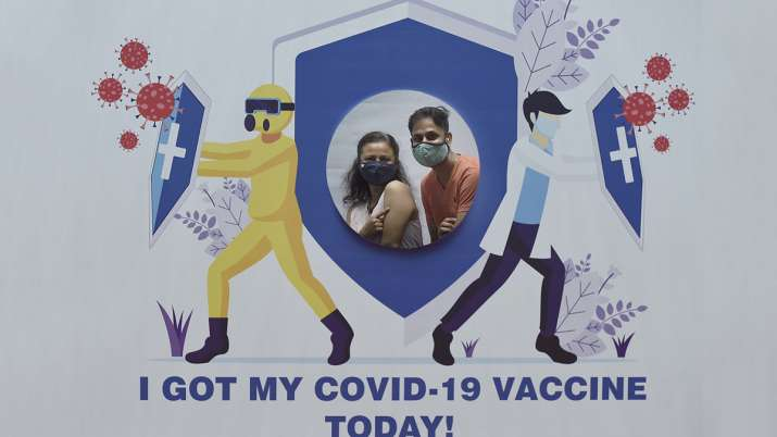 A couple poses for a picture after getting inoculated with