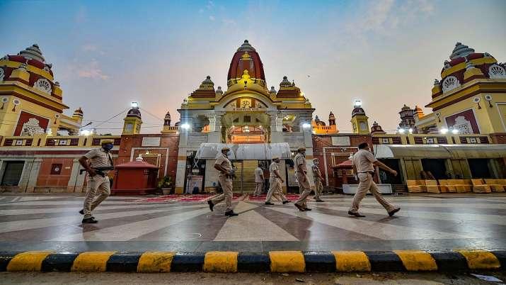 Police personnel guard at the Laxmi Narayan Birla temple on