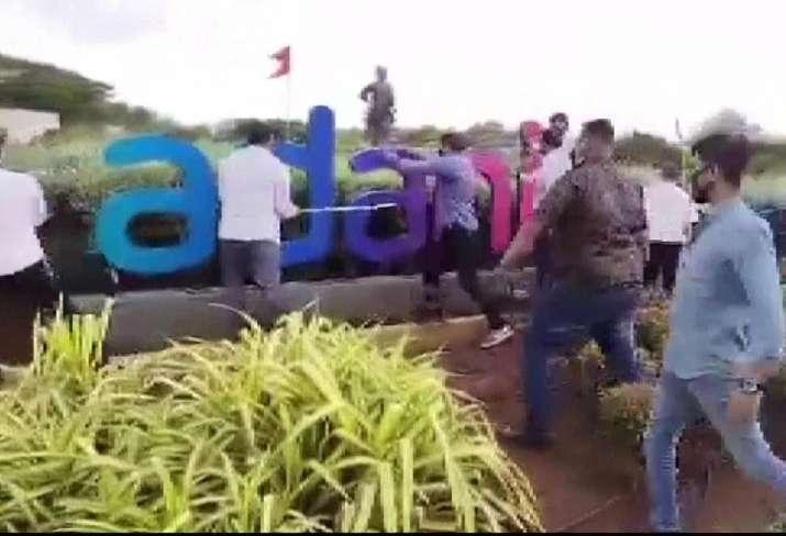 Shiv Sena workers vandalise 'Adani Airport' signboard in