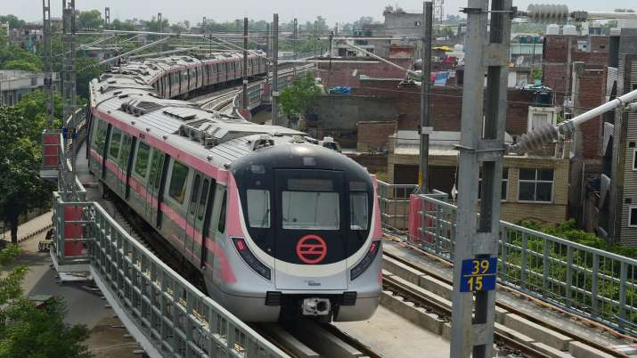 A metro train runs on a track after Delhi Metro's remaining