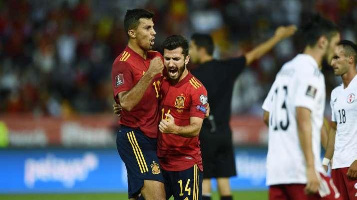 Spain's Jose Gaya, 2nd left, celebrates after scoring his