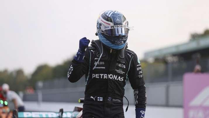 Mercedes driver Valtteri Bottas of Finland reacts after he