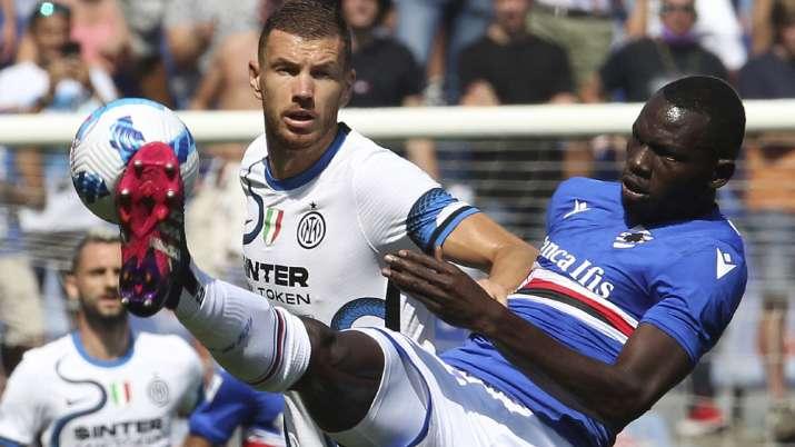 Inter's Edin Dzeko, left, and Sampdoria's Omar Colley vie