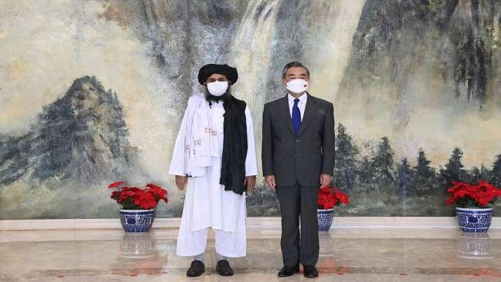 Taliban co-founder Mullah Abdul Ghani Baradar, left, and