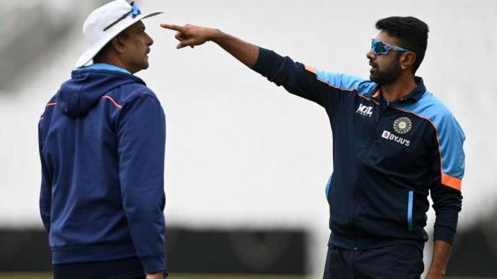 Ravichandran Ashwin of India speaks with coach Ravi Shastri