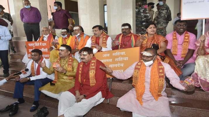 BJP legislatures wearing traditional attire chanting Vedic
