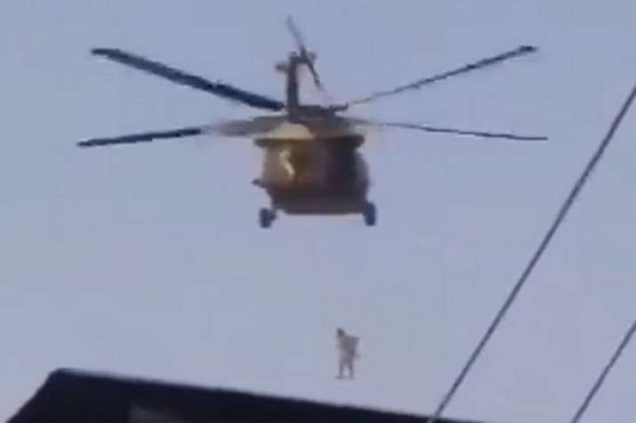 man seen hanging from US helicopter