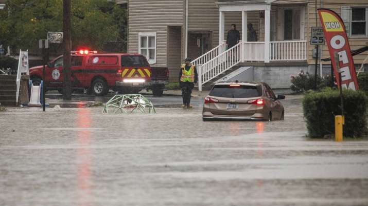 A car is stranded on a flooded street Wednesday, Sept. 1,