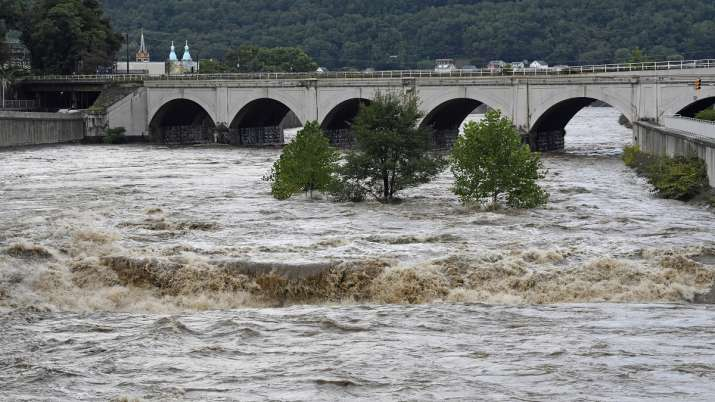 India Tv - A raging Little Conemaugh River is shown at its confluence with the Stonycreek Rivers (which form the Conemaugh River) at the historic Stone Bridge in downtown Johnstown, Pa., Wednesday, Sept. 1, 2021.
