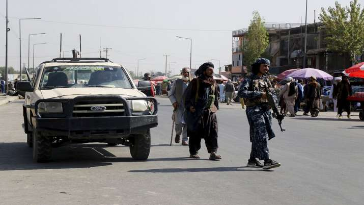 Taliban fighters walk in the city of Kabul, Afghanistan.