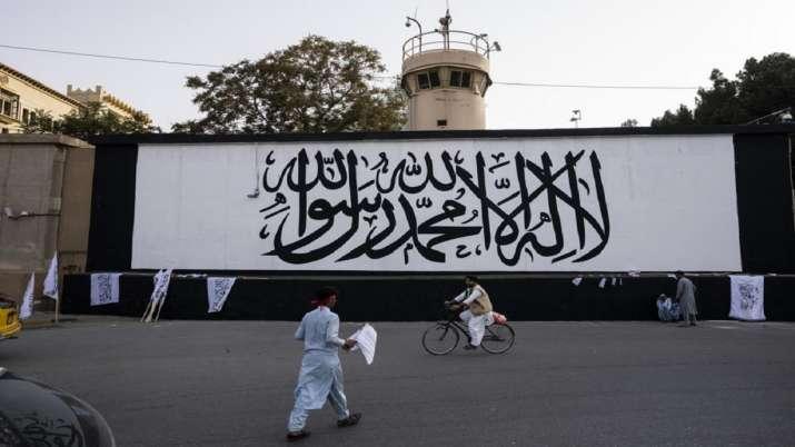 Taliban flag, seat of power, fateful 911 anniversary, Quranic verse, Mullah Mohd Hassan Akhund, Tali