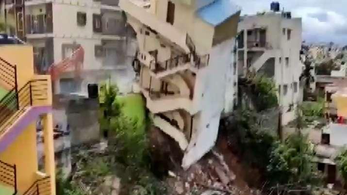 Tilted building evacuated, demolished in Bengaluru.