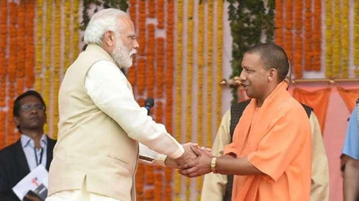 UP CM Adityanath presents Lord Buddha's idol to PM Modi