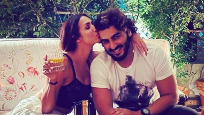 Malaika Arora plants kiss on Arjun Kapoor's cheeks as he pens most romantic birthday wish for her