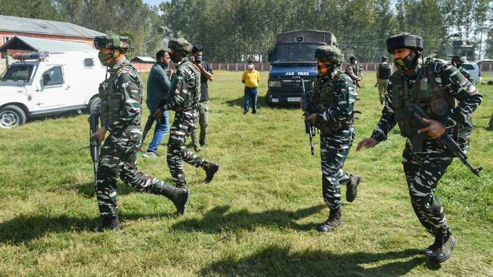 Security personnel arrive at a school in Srinagar after