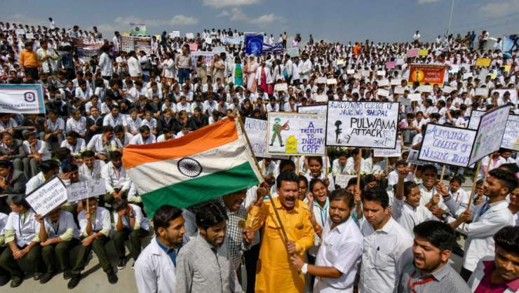 Students wave Tricolour and display placards while celebrating Indian Air Force (IAF)'s strike on Je - India Tv