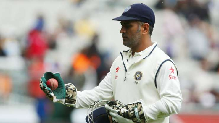 MS Dhoni of India leaves the field on day five of the Third Test match between Australia and India at Melbourne Cricket Ground on December 30, 2014 in Melbourne, Australia. - India Tv