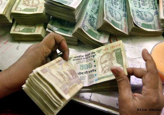 rupee down at 13 paise against dollar in early trade