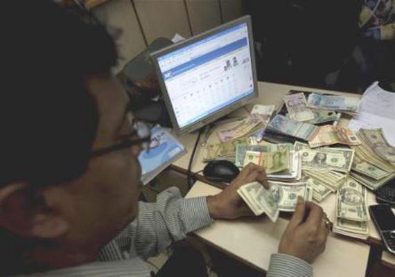 rupee up marginally closes at 49.19/20 against dollar