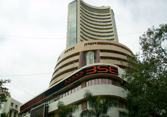sensex reverses losses to end 51 pts up hindalco tcs shine