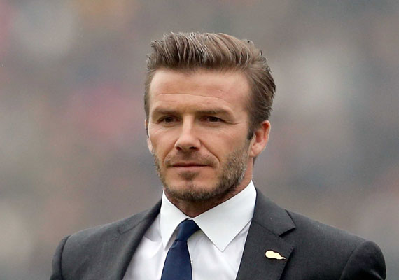david beckham flaunts toned abs in new ad