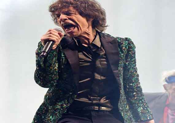 mick jagger flaunts jacket made of leaves