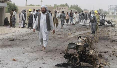 afghan police suicide bomber kills 9 in northwest