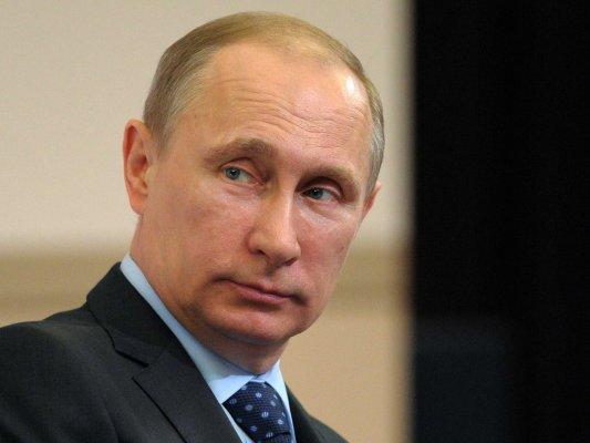 putin merkel call for new talks between kiev separatists