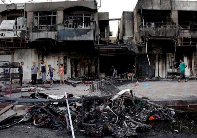 iraqi officials say baghdad market bombings kill 26 people