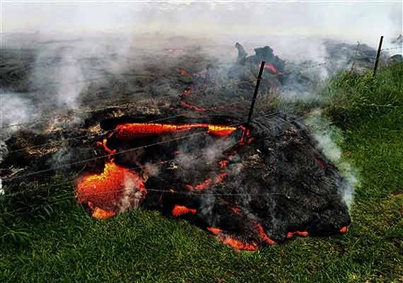 in pics red hot lava nears hawaii home and main road