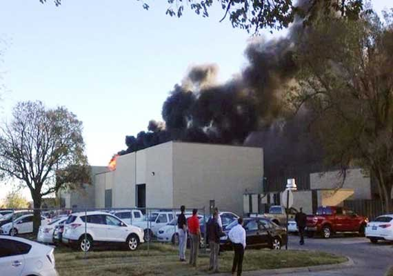 four die as plane crashes into building in us