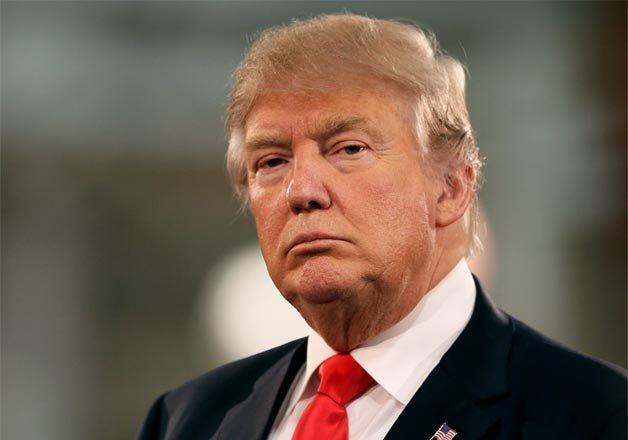 bernie sanders accuses donald trump of racist effort