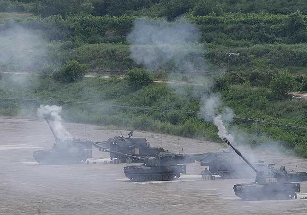 north korea warns of war with south korea after artillery