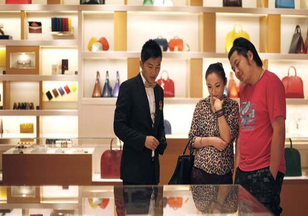 china buys half of all luxury goods report