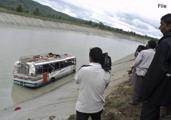 two killed over 40 feared drowned as bus falls into canal