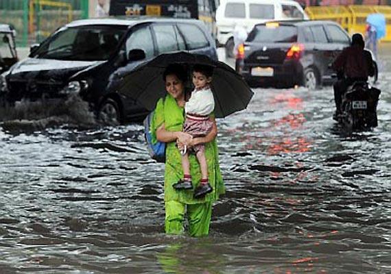heavy rains lash delhi ncr flood threat looms large
