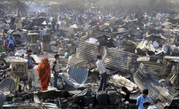 over 50 houses gutted in delhi slum fire