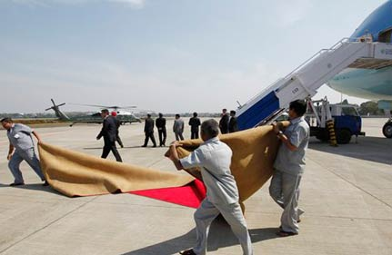 winds blow away red carpet laid out for obamas send off